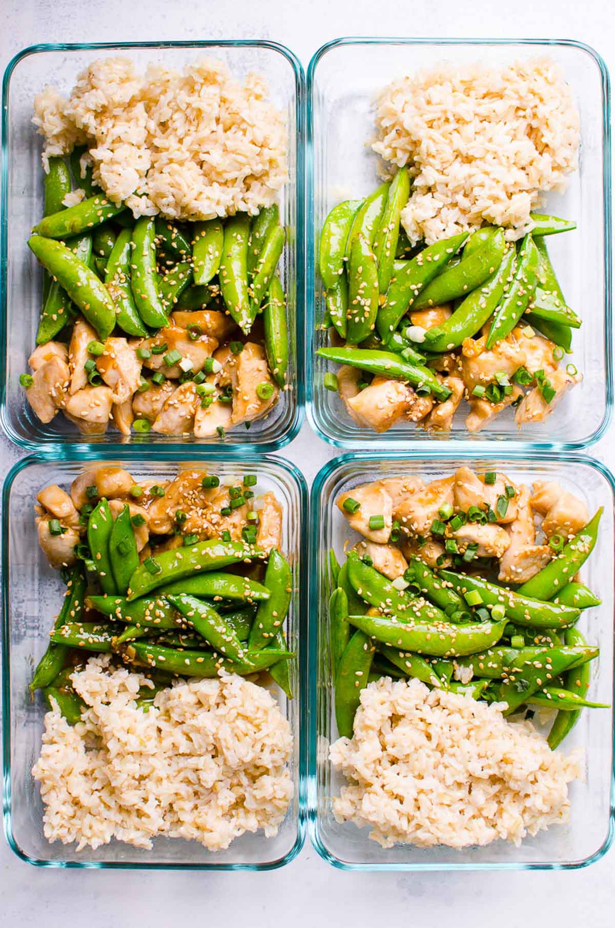 Healthy Teriyaki Chicken Meal Prep with chicken, snap peas and brown rice in 4 glass containers.