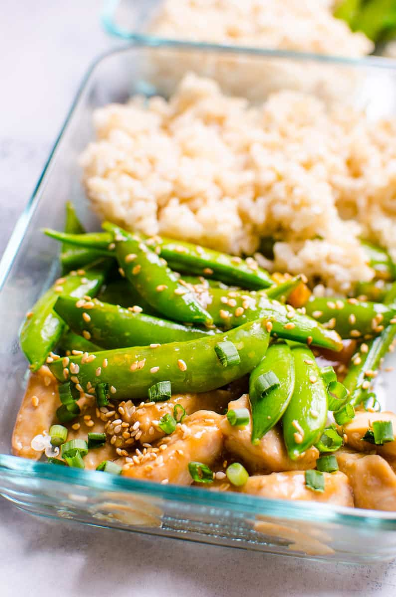 Healthy Teriyaki Chicken Meal Prep closeup of glass container of chicken, snap peas  and brown rice.