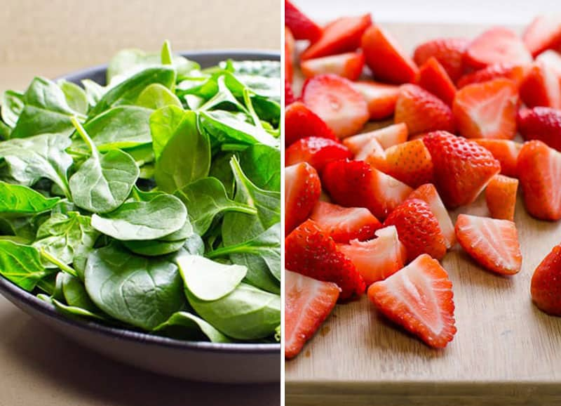 spinach in a bowl and sliced strawberries