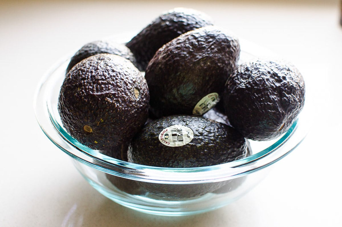 ripe avocados in a glass bowl