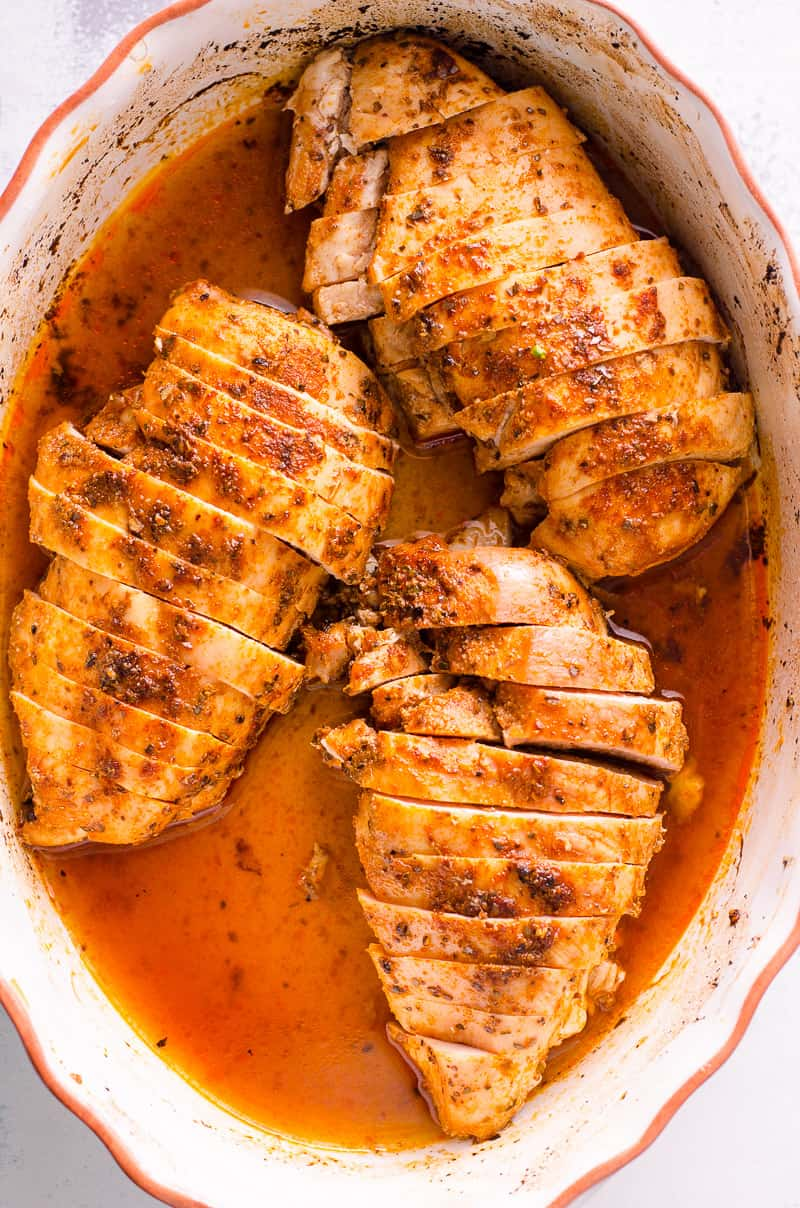 How to make juicy baked chicken breast with 5 minutes of prep using 2 pro tips. Then use in salads, main dishes or meal prep for the week. Easy, tasty and healthy basic chicken breast recipe that will become your go-to.