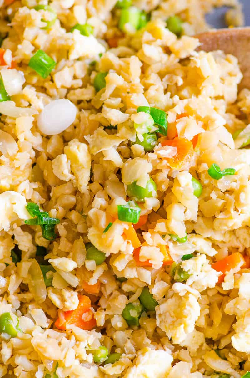 Super easy 15 minute Cauliflower Fried Rice Recipe with fresh or frozen cauliflower. It is SO TASTY my kids thought it was real rice.