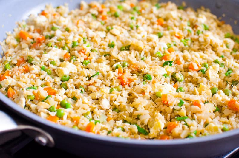 How to make Cauliflower Fried Rice with fresh or frozen cauliflower in 15 minutes. It is SO TASTY my kids thought it was real rice.