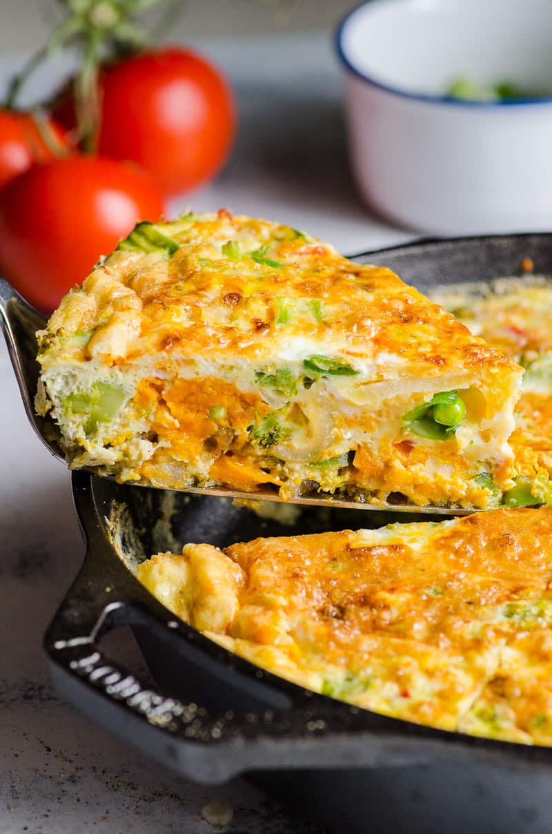 Vegetable Frittata slice in a cast iron skillet