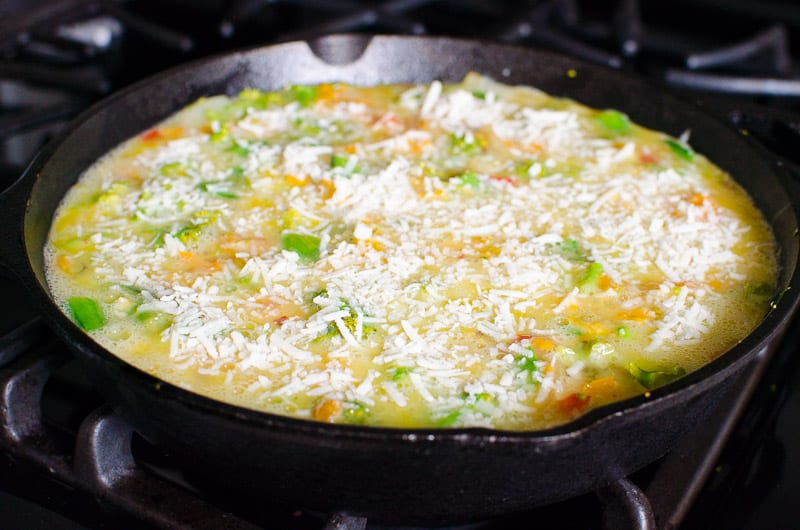 Frittatas are so easy and healthy! This Vegetable Frittata Recipe incorporates any leftover veggies and cheese, then bake in a cast iron skillet with dozen eggs. That's it, my friends!