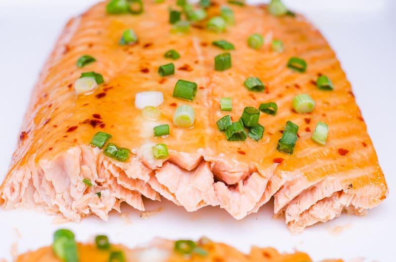 Cedar Plank Salmon garnished with green onion