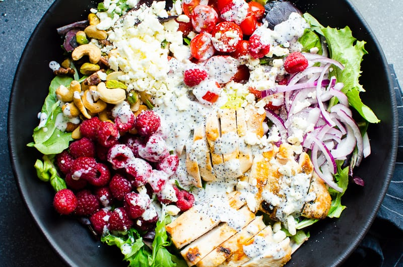 healthy poppyseed dressing drizzled on grilled chicken salad