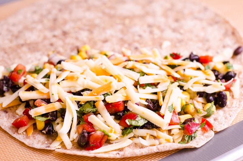 Healthy Vegetarian Quesadilla Recipe with beans, vegetables and moderate amount of cheese tucked inside a whole wheat tortilla and baked in the oven for the best EASY veggie quesadilla ever!