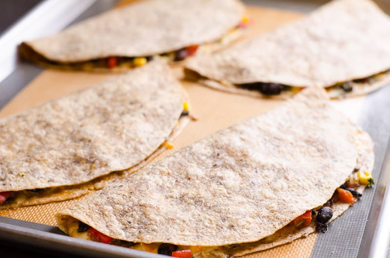 Healthy and So Easy Vegetarian Quesadilla Recipe with black beans, veggies and moderate amount of cheese tucked inside a whole wheat tortilla and baked. Or turn into a freezer meal for busy nights.