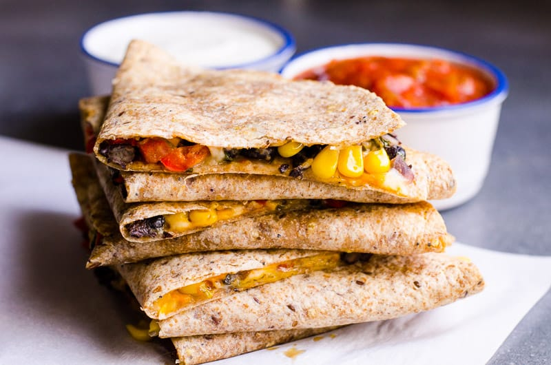 vegetarian quesadilla recipe stacked and served with sour cream and salsa