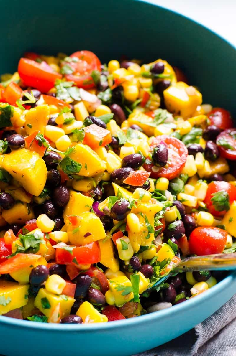 black bean and corn salad with mango, tomatoes, bell pepper, cilantro and lime