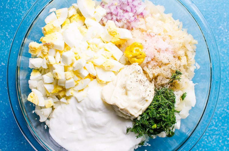 Cauliflower Potato Salad Recipe made with cauliflower which reduces carbs and calories A LOT but doesn't lack flavour. This mock potato salad will blow your mind!