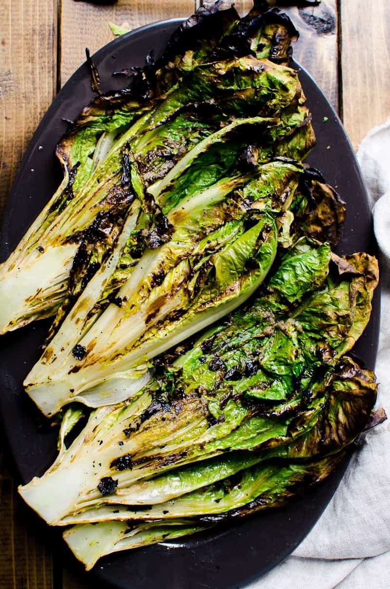 grilled romaine lettuce on a serving platter