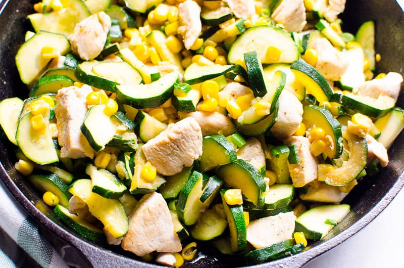 This Garlic Chicken Zucchini and Corn Recipe is a 20 minute healthy weeknight dinner that was inspired by my Ukrainian roots. Low carb, easy and one pan deliciousness!