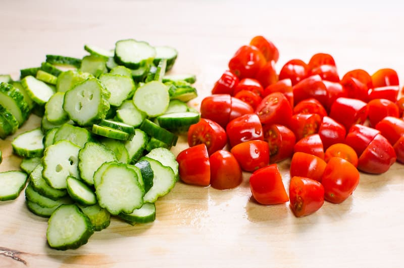 Sliced cucumbers tomatoes for cucumber tomato and onion salad