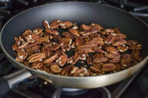 pecans sauteed in a skillet