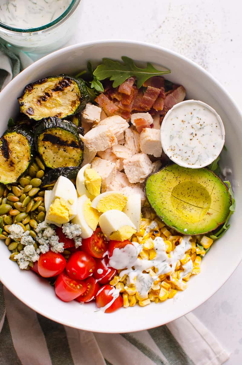 Healthy Cobb Salad in a bowl drizzled with healthy ranch dressing