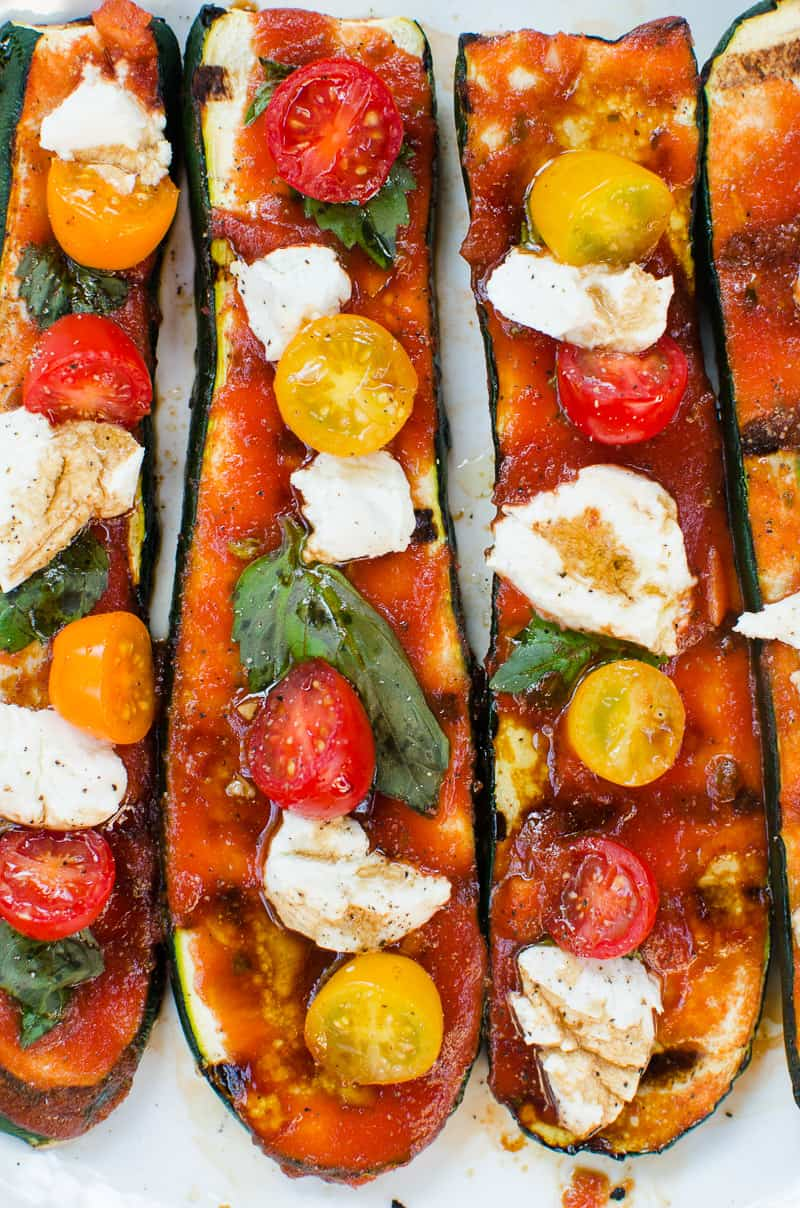 Healthy and low carb Grilled Zucchini Pizza, Bites or Boats, or whatever you name them. Will satisfy your pizza cravings with low calories in 15 minutes!