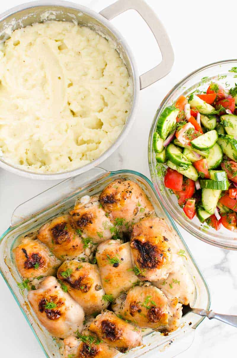 baked chicken, mashed potatoes and cucumber tomato salad