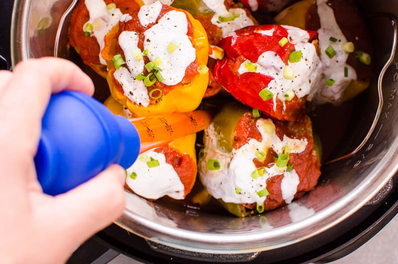 Instant Pot Stuffed Peppers Recipe with ground turkey and uncooked quinoa for a quick one pot dinner or turn into a freezer meal.