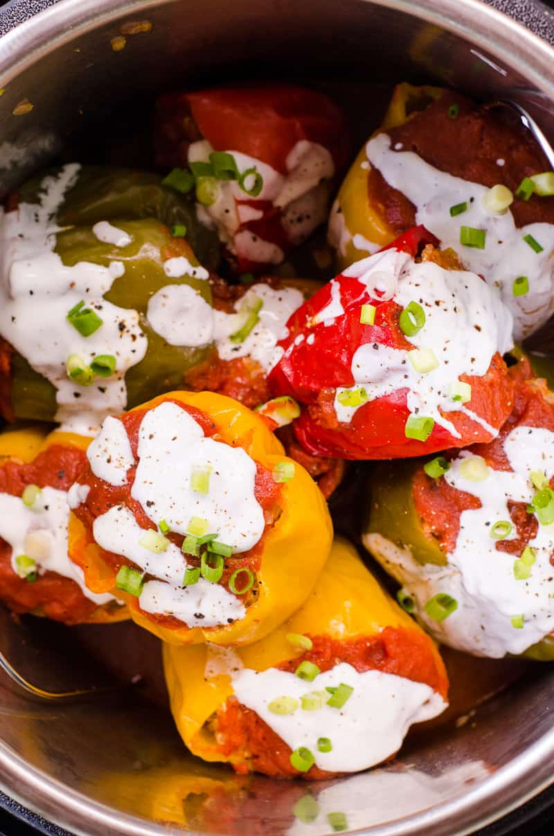 Instant Pot Stuffed Peppers garnished with yogurt and green onion