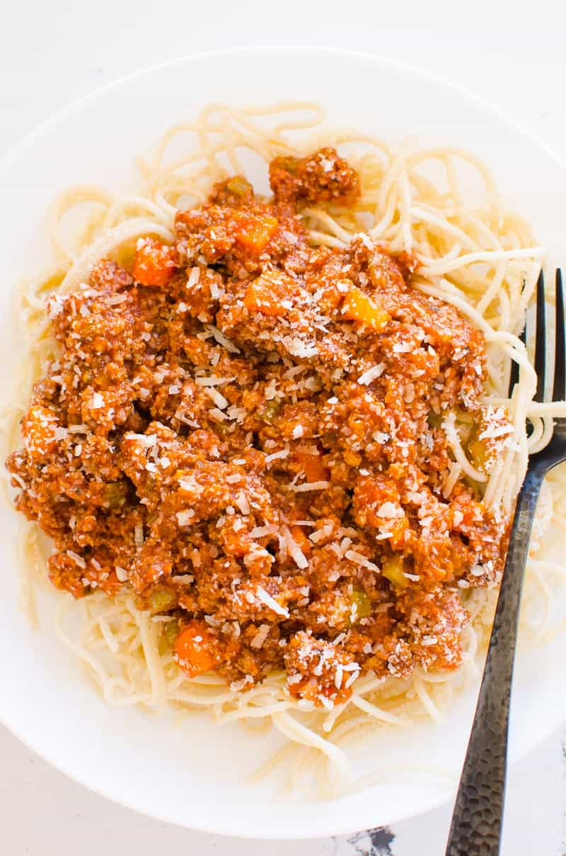 Instant Pot Bolognese recipe on white plate and black fork