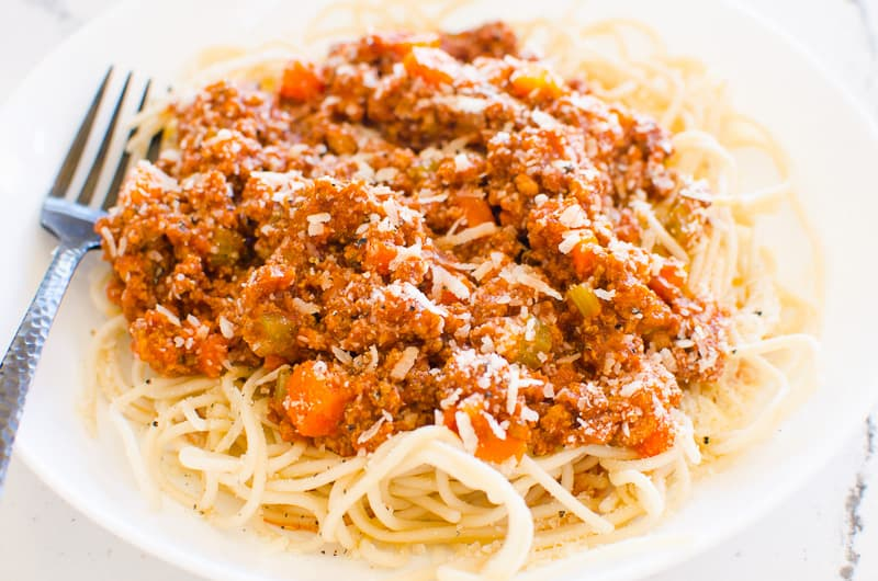 Instant Pot Bolognese over spaghetti on a plate
