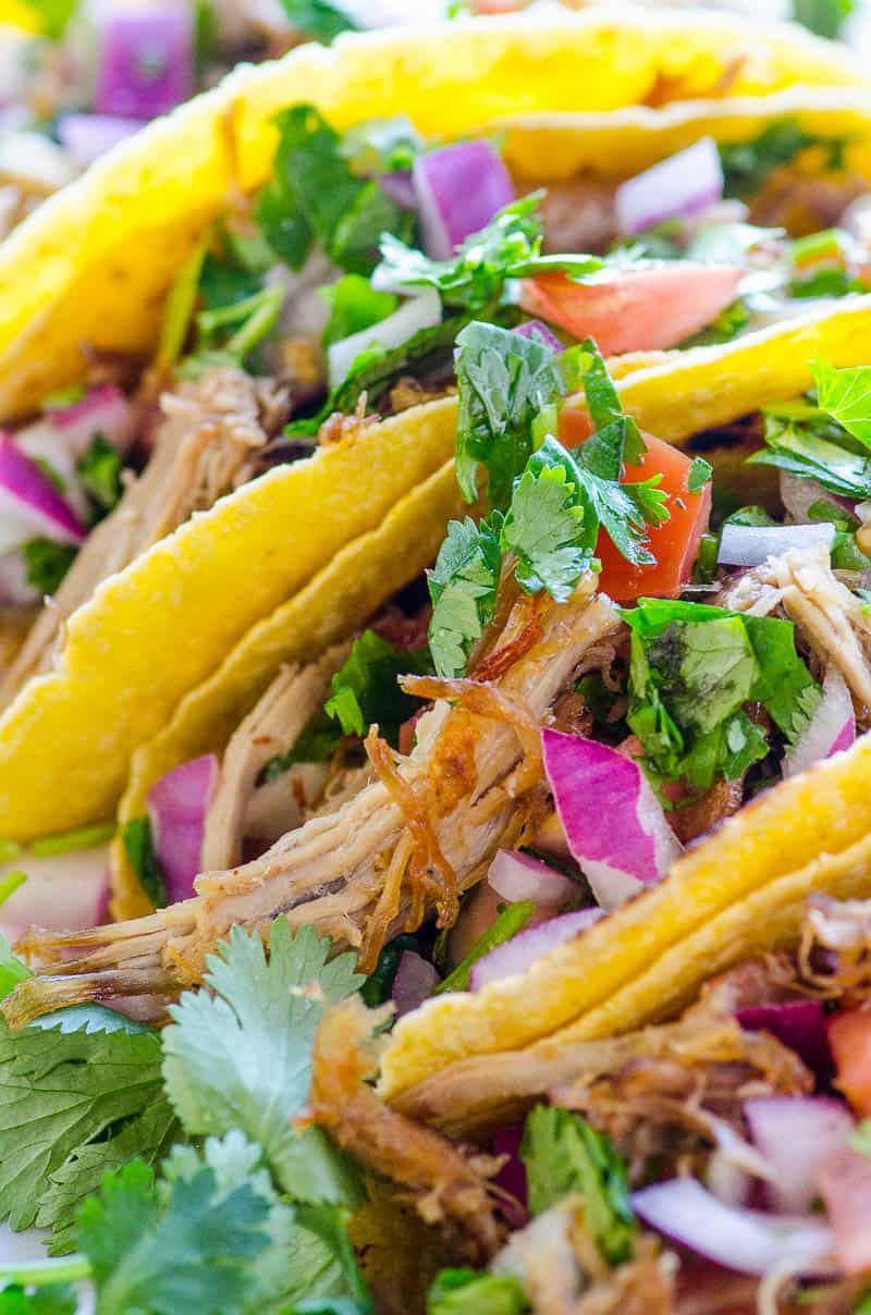 Crispy and juicy Mexican pulled pork tacos in Instant Pot without coke. With quick pickled onions that are to-die-for!