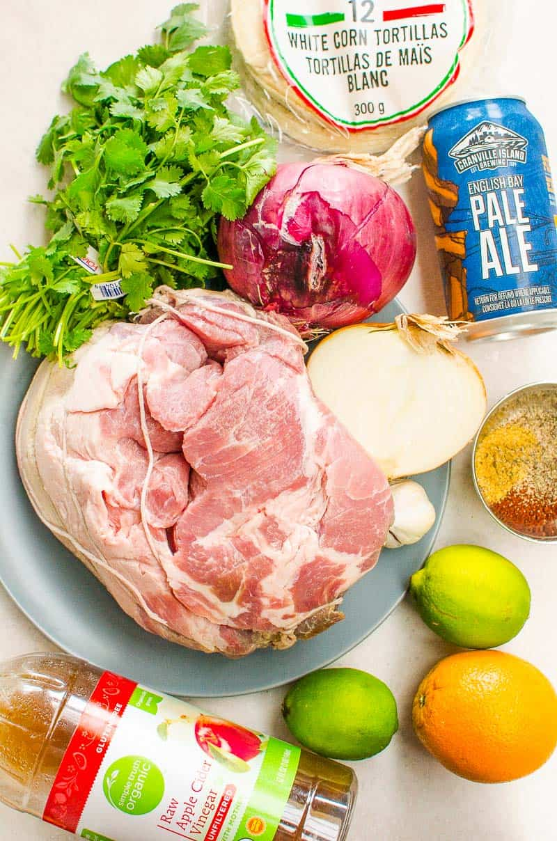 Instant Pot Carnitas ingredients include pork roast, orange, limes, onion, garlic, beer, vinegar and spices
