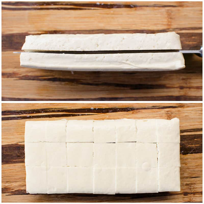 tofu being cut into cubes on cutting board