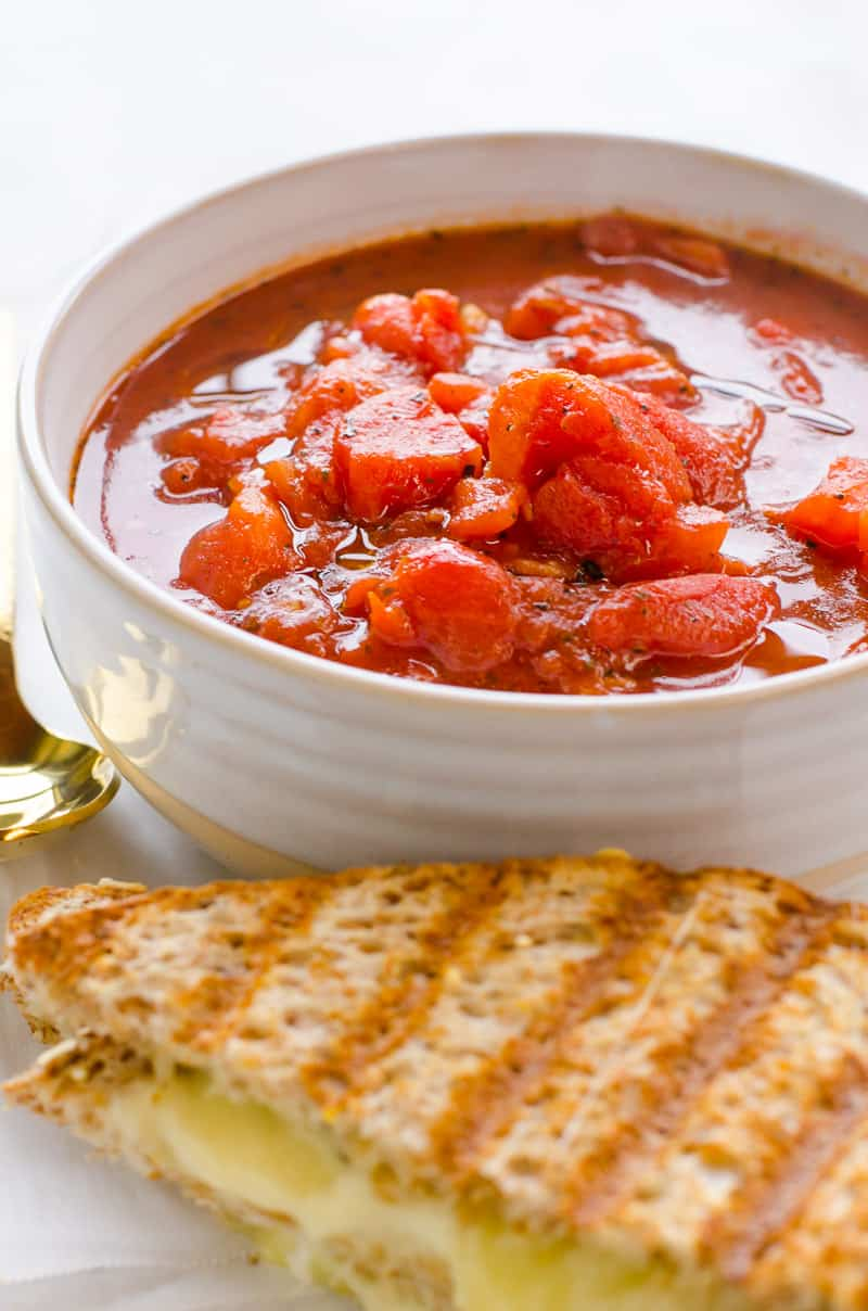 This is EASY and BEST homemade tomato soup with canned tomatoes and grilled cheese for a 10 minute healthy dinner.