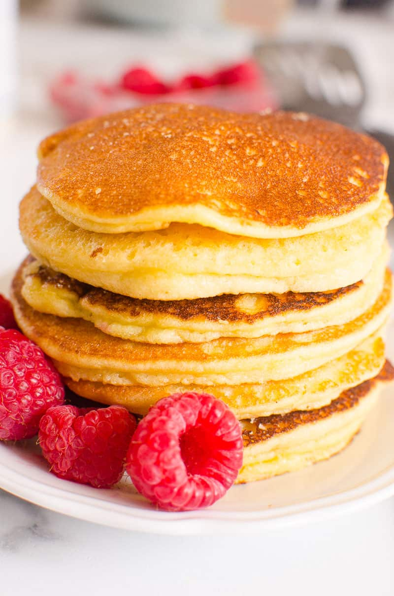 Almond Flour Pancakes stacked and garnished with raspberries
