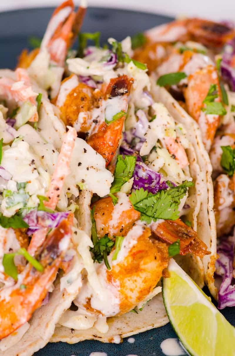 easy shrimp tacos recipe garnished with lime wedge
