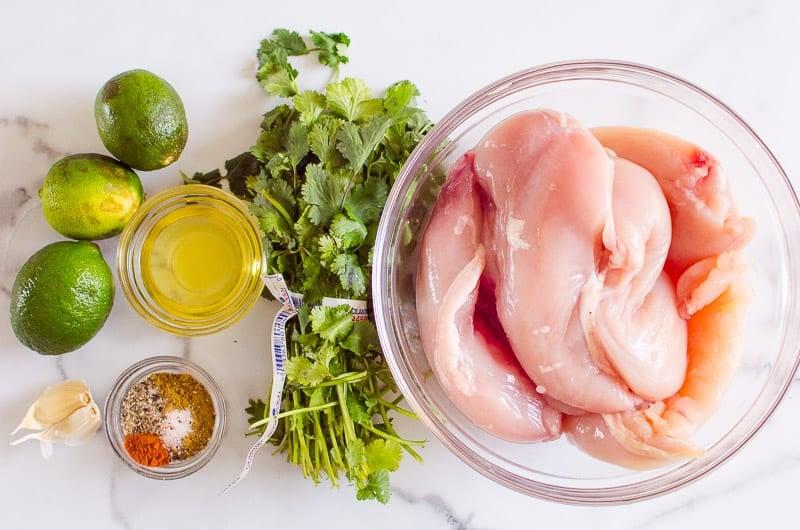limes, cilantro, garlic, cumin, oil, spices and chicken breasts
