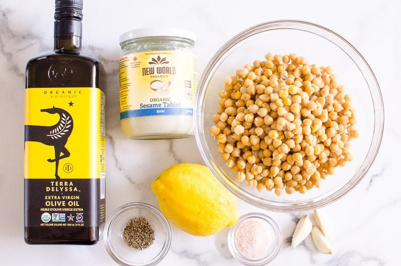 hummus recipe ingredients include chickpeas, olive oil, tahini, lemon, garlic and spices
