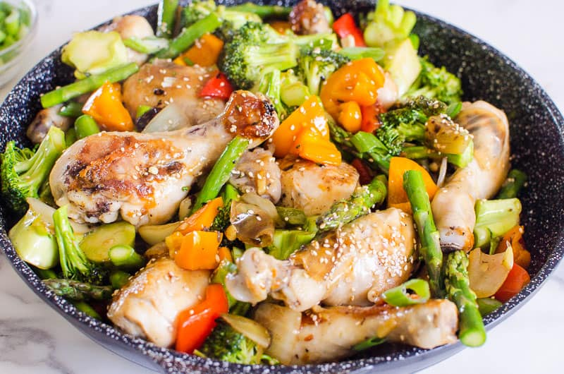 chicken stir fry garnished with sesame seeds
