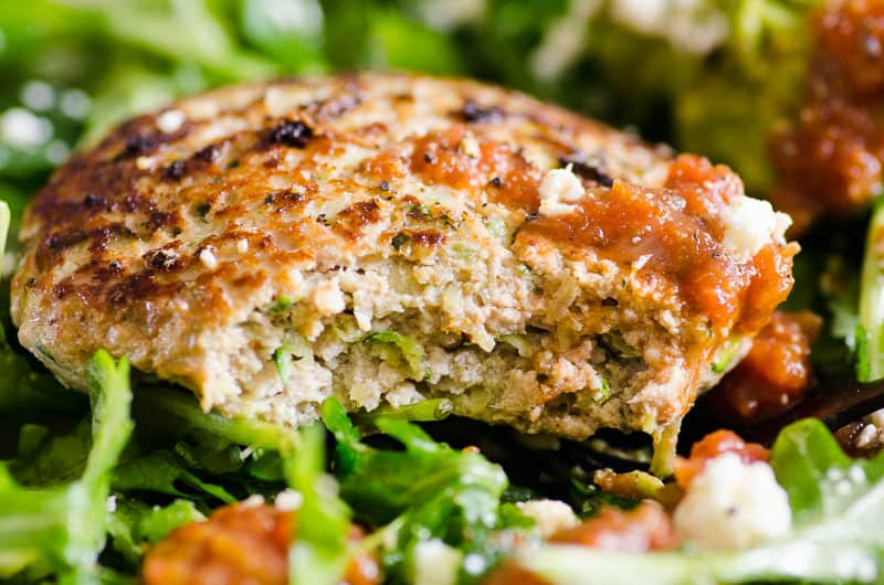 the best juicy turkey burger served on a bed of greens