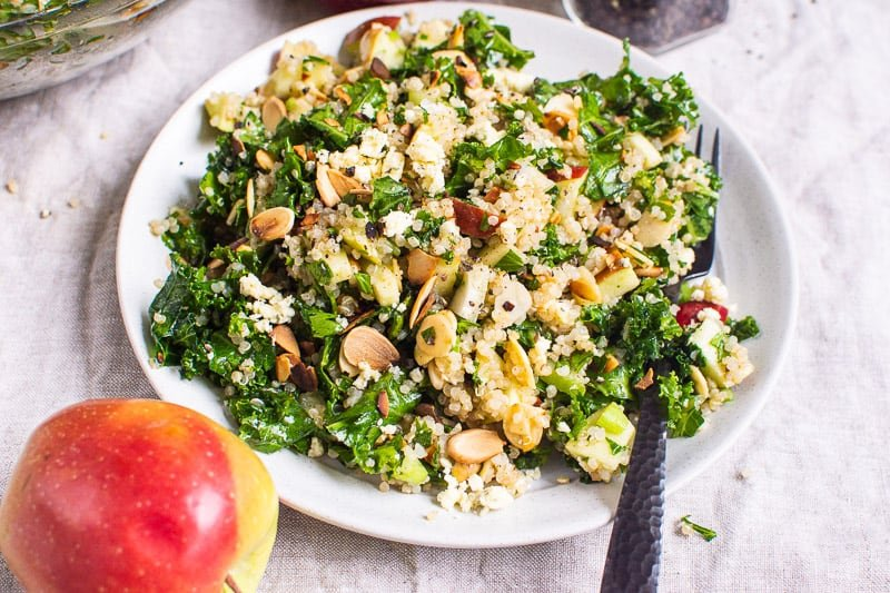 Kale and Quinoa Salad on white plate with black fork