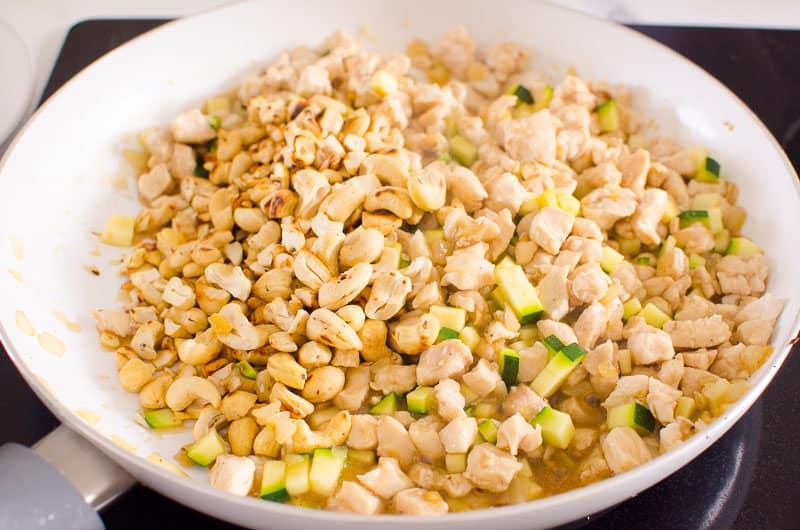 adding ingredients to skillet for lettuce wraps