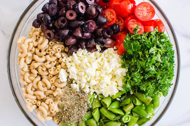 chopped ingredients in a bowl for easy pasta salad