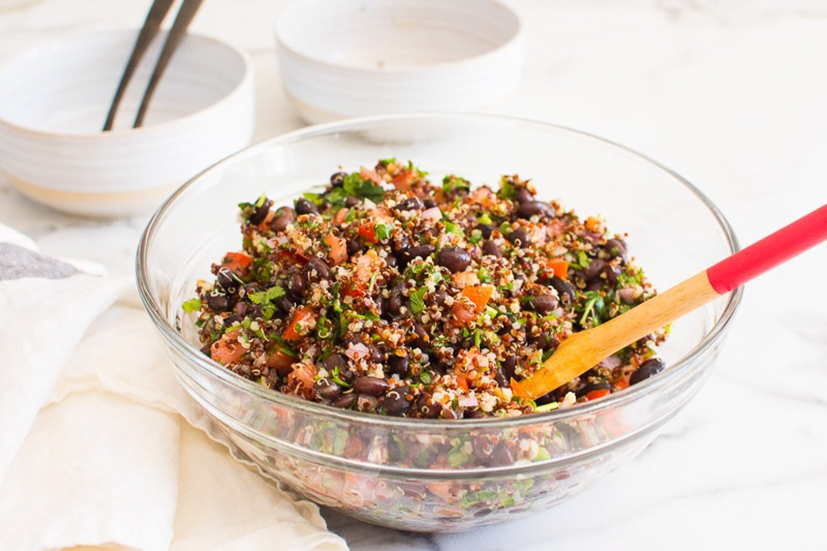 quinoa and black bean salad in a bowl with a spoon