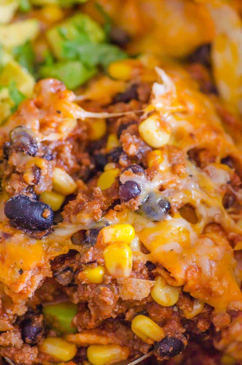 closeup cheesy skillet enchiladas with black beans and corn