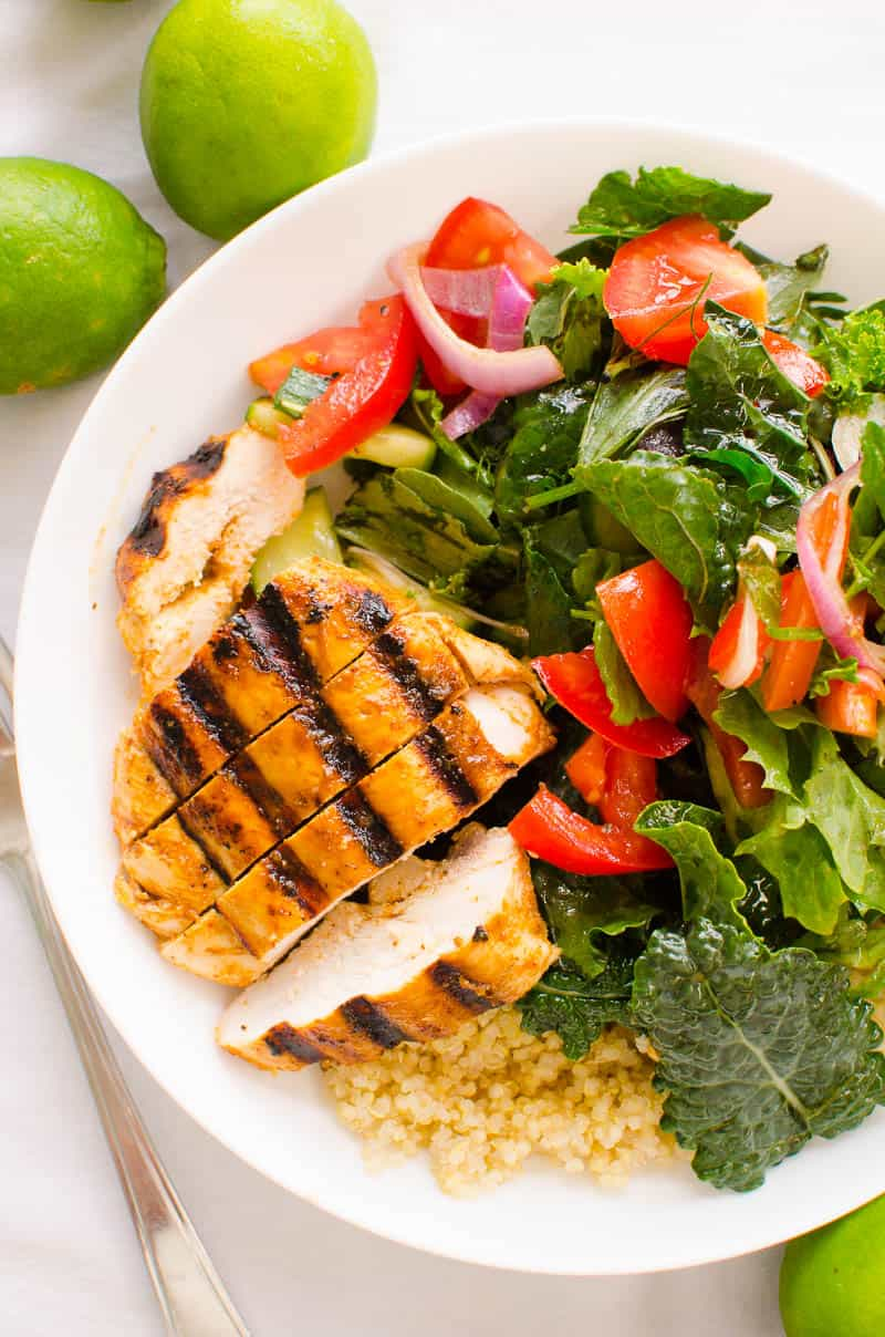 sliced chili lime chicken served with salad and quinoa