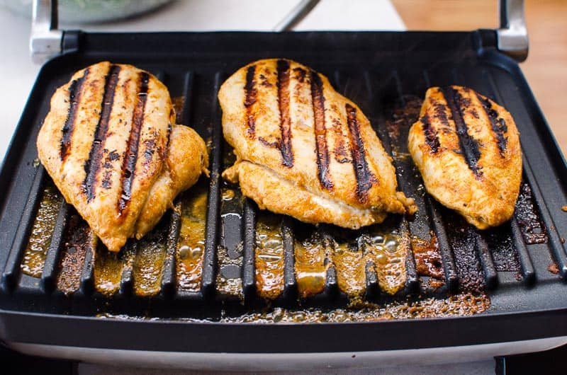 grilled chicken with chili and lime on the grill