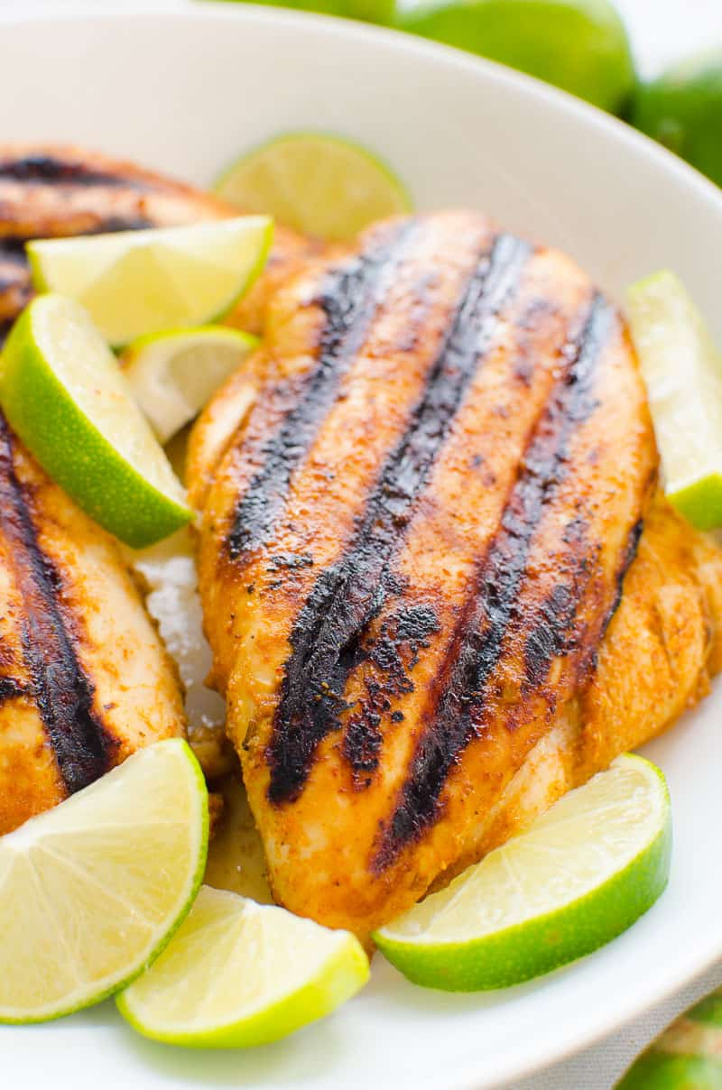 chili lime chicken on a plate with limes