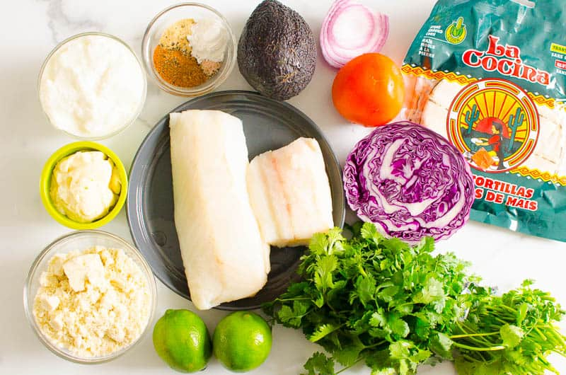 fish, corn tortillas, lime, cheese, avocado, tomato, cabbage, yogurt, spices, mayo, cilantro