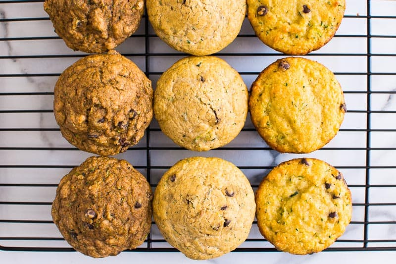 healthy zucchini muffins lined up on cooling rack