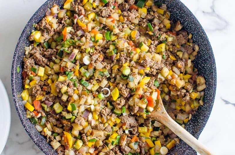 korean ground beef in a skillet with a spoon