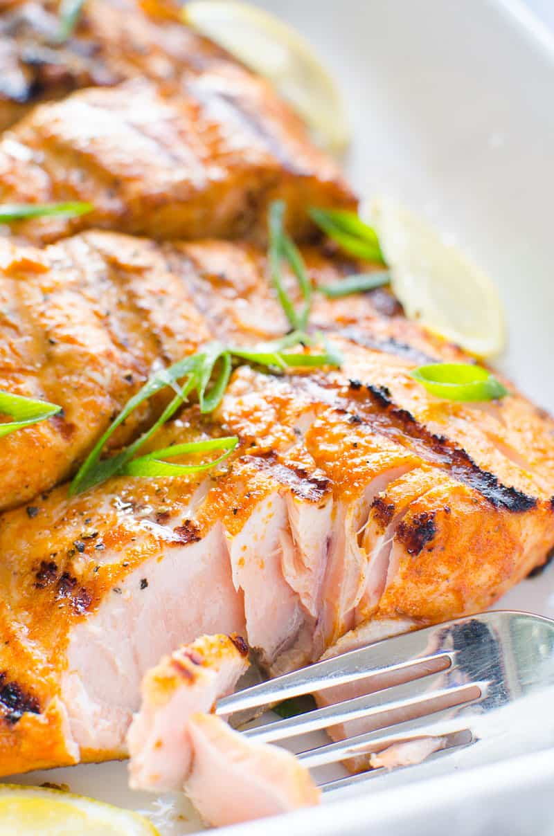 grilled salmon flaked with a fork