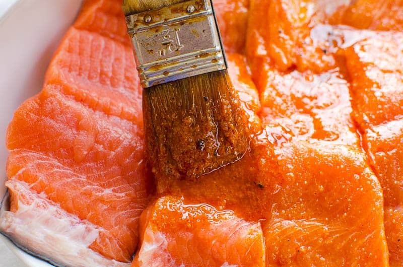 salmon seasoning brushed on salmon